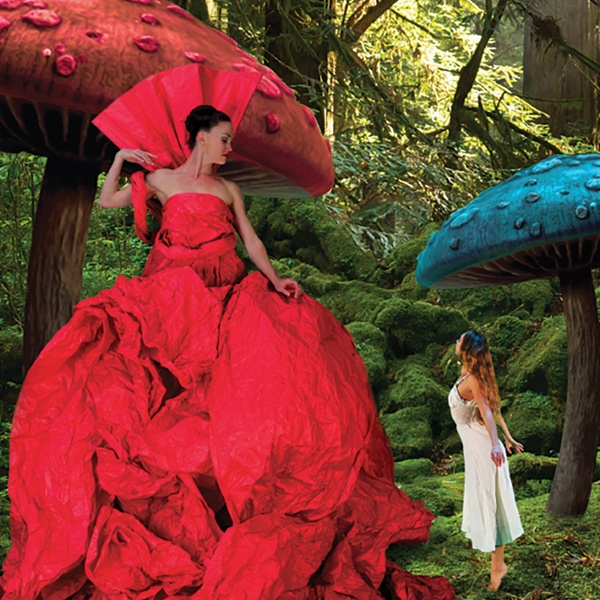 Scene from Alice showing performers and large mushrooms
