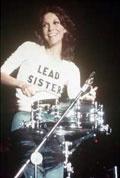 Karen Carpenter at the drums wearing her Lead Sister shirt.