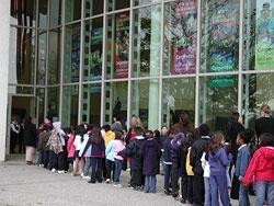 Schoolchildren lined up outside the Carpenter Center lobby